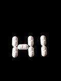 Pillole sul nero Fotografie Stock