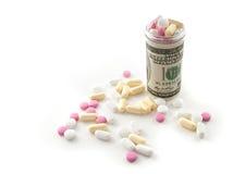 Pillole in una bottiglia fatta di soldi Fotografia Stock