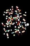Pillole variopinte da sopra Immagine Stock