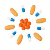 Pillole variopinte nel reticolo circolare. Immagini Stock