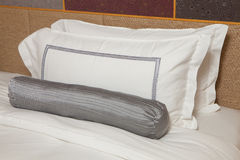 Pillow. White pillow and cushion on the bed Stock Photos
