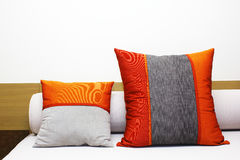 Pillow. Bed and two colorful pillow Stock Images