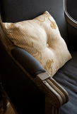Pillow. Ornate stripped pillow on the old stile armchair Stock Photo