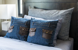 Pillow on the bed. In home Stock Image