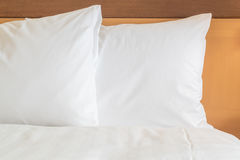 Pillow on bed in hotel room Royalty Free Stock Photo