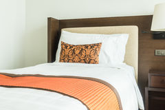 Pillow on bed. White pillow on bed decoration in bedroom interior with table light lamp royalty free stock photo