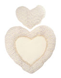 Pillow beige heart on white Stock Photos