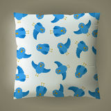 Pillow with blue bird pattern. Stock Photography