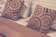 Pillow brown color on a bed Royalty Free Stock Image