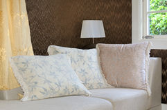 Pillow cushions On Sofa. Detail of modern living room with table lamp and pillow cushions on sofa Royalty Free Stock Photography