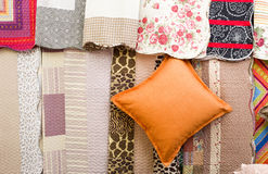 Pillow and fabrics for sale Stock Image