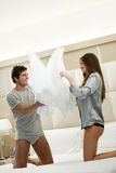 Pillow Fight. Couple doing pillow fight in hotel royalty free stock photos