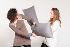 Pillow Fight. Between Two Beautiful Women royalty free stock images