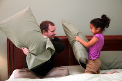 Pillow Fight. Father and Daughter having a pillow fight stock photos