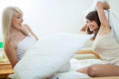 Pillow fight. In the bedroom royalty free stock image