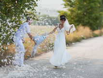 Pillow Fight. Bridal couple playing with feathers Stock Images