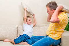 Pillow fight on the couch Royalty Free Stock Image