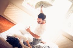 Pillow fight between couple. stock images