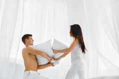 Pillow Fight. Couple having fun stock images