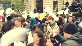 Pillow fight day. Group of unidentified people participate in pillow fight on International Pillow Fight Day on April 5, 2014 in University Square, Bucharest stock video footage