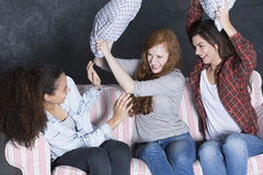 Pillow fight with friends Stock Image