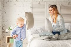 Pillow Fight. Happy Mother and Son Having Fun. At Home. Woman and Child Boy, Happy Family Stock Photos