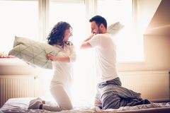 Pillow fight, Playful young couple. royalty free stock photo