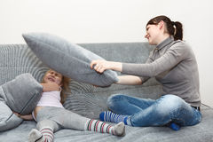 Pillow fighting on the sofa. Royalty Free Stock Images
