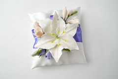 Pillow with flowers on a gray Stock Image