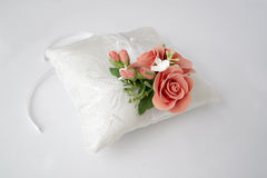 Pillow with flowers on a white Royalty Free Stock Photo