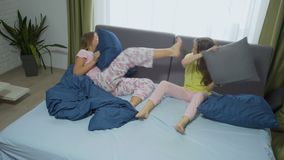 Pillow friendly match. Friendly match. happy friends having fun together. two girls fighting pillows stock video footage