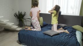Pillow friendly match. Friendly match. happy friends having fun together. two girls fighting pillows stock video