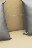 Pillow gray color on bed brown or beige in bedroom Stock Photography