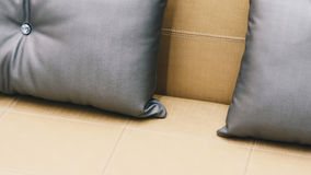 Pillow gray color on bed brown or beige in bedroom Stock Images
