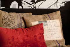 Pillow layout. Red and sackcloth pillows closeup in grunge style decorated arrangement Royalty Free Stock Photography