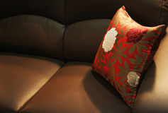 Pillow on a leather sofa Royalty Free Stock Photos