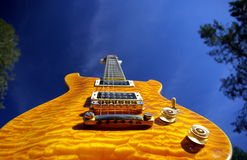 Pillow Maple Guitar. A pillow maple guitar body against a blue sky Royalty Free Stock Images