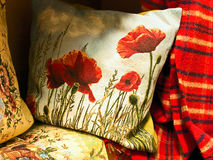 Pillow with poppy Stock Photo