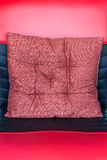 Pillow on red-black leather Royalty Free Stock Images