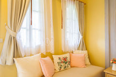 Pillow on sofa and curtain in the room Royalty Free Stock Photos