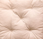 Pillow texture. Detail of beige soft pillow texture background Royalty Free Stock Photo