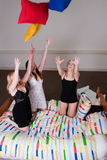 Pillow throwing at our pyjama party Royalty Free Stock Photography