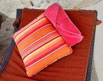 Pillow and towels for the beach Stock Images