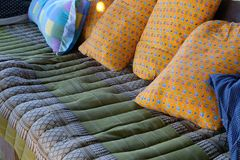 Pillow & traditional green cushion from Thailand. Orange pillow & traditional green cushion from Thailand royalty free stock photos