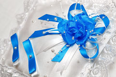 Pillow for wedding rings with blue ribbons Royalty Free Stock Photos