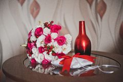 Pillow for wedding rings and a bunch of flowers 2079. Stock Photo