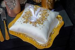 Pillow for the wedding rings on dark background. stock image