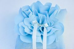 Pillow for wedding rings. Sky blue with two white ribbons otlasnymi Stock Images