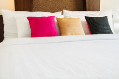 Pillow on white bed Royalty Free Stock Photos