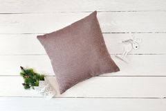 Pillow on a white wooden christmas background. Flat lay, top view photo mockup stock photography